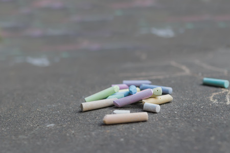 blacktop: Blacktop surface is covering with sidewalk chalking drawings Stock Photo