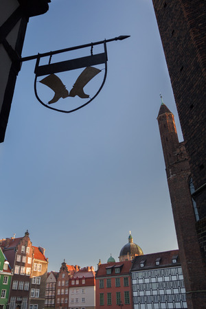 guild: View of medieval Gdansk old city center buildings with wrought iron guild sign