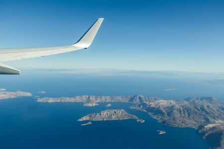 Aeral window shot of Greek Telendos and part of Kalymnos islands in blue Aegean sea