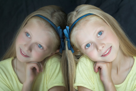 alice band: Head and shoulders indoor portrait with glass reflection of teenage blonde cute girl Stock Photo