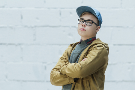 Portrait of teenage is wearing cotton blue baseball cap and looking at camera