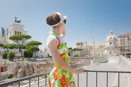 Back view of tourist girl is looking ahead on Roman ruins Reklamní fotografie