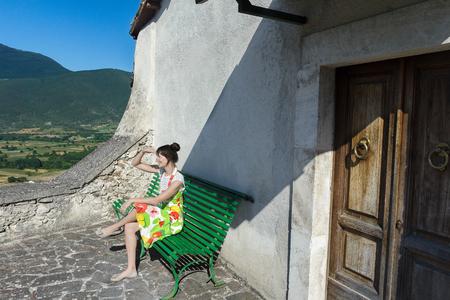 Girl is looking at Italian mountain rural landscape in Abruzzo region