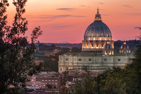 Rome architectural masterpiece during pink summer sunset in Italian capital