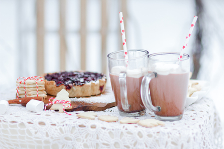 Christmas still life with berry pie cookies and marshmallows in hot cocoa drink