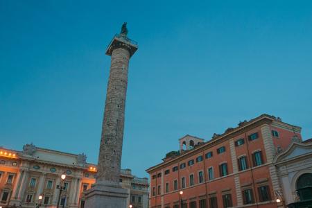 Italian Piazza Colonna with Roman Doric Column of Marcus Aurelius in dusk Rome