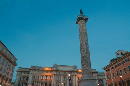 Ancient Roman Column of Marcus Aurelius in Piazza Colonna in evening Rome Banco de Imagens