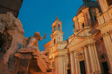 Danube river God sculpture representing Europe in Fountain of the Four Rivers pointing on dusk Sant Agnese church Archivio Fotografico