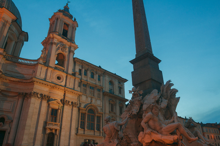 Italian Piazza Navona with Fountain of the Four Rivers and Sant Agnese church in Rome outdoors