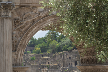 View of Palatine Hill ancient ruins through the Arch of Septimius Severus in summer Roman Forum