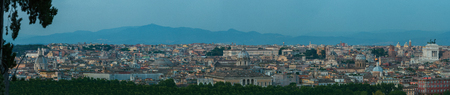 Wide dusk urban skyline panorama of Rome with main architectural international landmarks from Janiculum hill viewpoint with famous Pantheon and Altare della Patria buildings