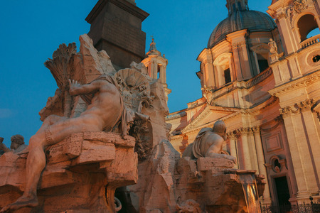 Stone Nile and Danube river gods sculptures in Sant Fatima of the Four Rivers pointing on Sant Agnese church outdoors