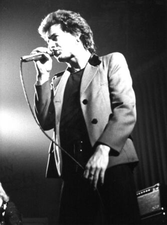 London, England - June 6, 1978 - Chris Turner, lead singer of British power pop group Tonight, performs live on stage.