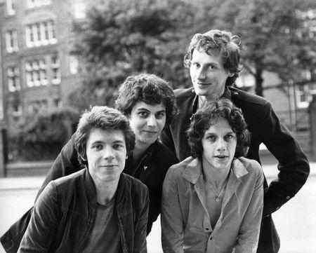 chris: London, England - August 20, 1978 - The Boyfriends, British power pop group, pose for the camera. L-R Mark Henry, Pat Collier (rear), Chris Skornia, Steve Bray.