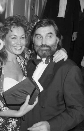 London, England - October 18, 1990 - George Best, England and Manchester United footballer, attends a celebrity event with girlfriend Mary Shatila