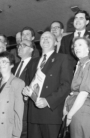 London, England - May 24, 1990 - Neil Kinnock, Labour Party Leader (centre) ,  poses with other politicians at a policy launch. Stock Photo - 6890347