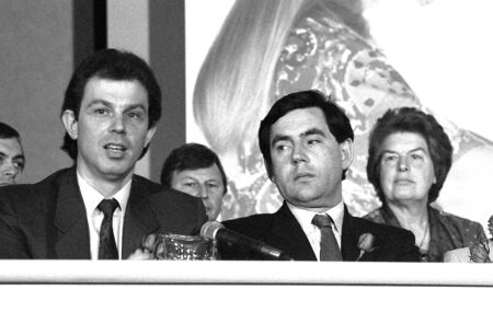 scottish parliament: London, England - May 24, 1990 - Tony Blair, former British Prime Minister and Gordon Brown, British Prime Minister, sit together at a press conference.