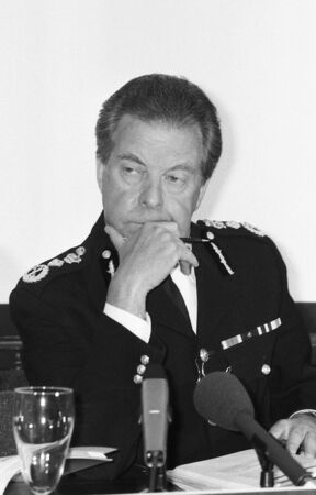 London, England - May 23, 1990 - Sir Peter Imbert, Commissioner of the Metropolitan Police Force, holds a press conference at New Scotland Yard. Stock Photo - 7278127