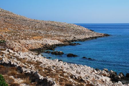halki: The rocky coastline by Pondamos beach on the Greek island of Halki.