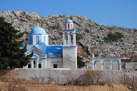 halki: The domed church at Emborio cemetery on the Greek island of Halki.