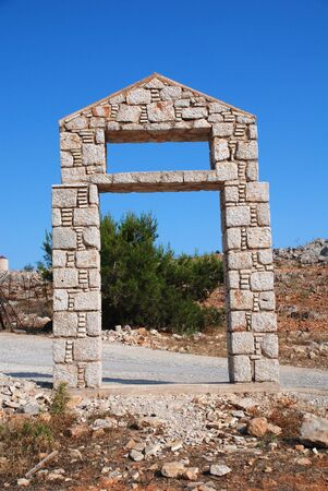 halki: Stone built entrance way outside the five a side football pitch at Emborio on the Greek island of Halki. Stock Photo