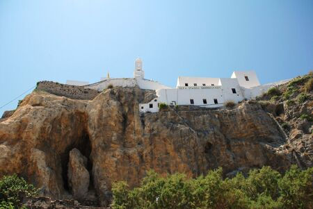The cliff top Monastery of Our Lady Spiliani at Mandraki  on the Greek island of Nisyros. Stock Photo