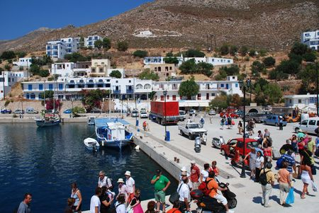 Tilos, Greece - June 12, 2010 - Passengers disembark from a ferry boat at Livadia harbour on the Greek island of Tilos.