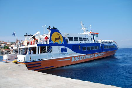 emborio: Halki, Greece - June 12, 2010 - Catamaran ferry boat the Dodekanisos Express docks at Emborio harbour on the Greek island of Halki.