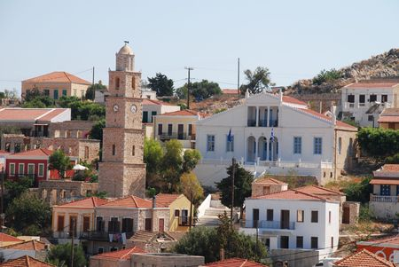 halki: he town of Emborio on the Greek island of Halki (showing the clock tower and white painted town hall in the centre).