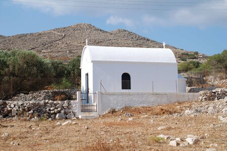 halki: A small chapel near Pondamos beach at Emborio, Halki island, Greece. Stock Photo