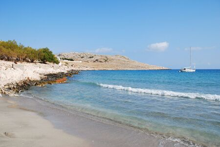 halki: Pondamos beach at Emborio on the Greek islannd of Halki. Stock Photo