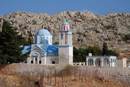 halki: The domed church at Emborio cemetery on the Greek island of Halki.