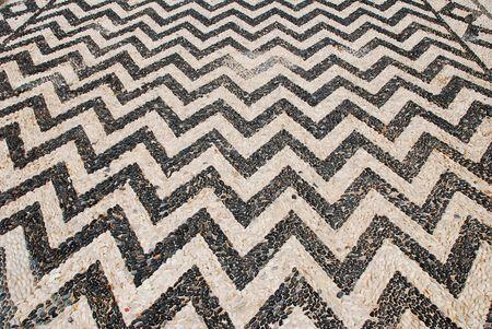 halki: The hoklakia mosaic courtyard of the Agios Nikolaos church at Emborio on the Greek island of Halki.