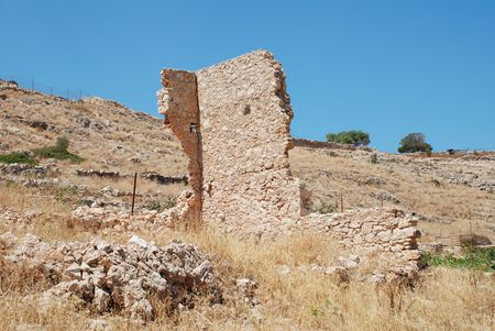 halki: A derelict old stone building in Emborio on the Greek island of Halki.