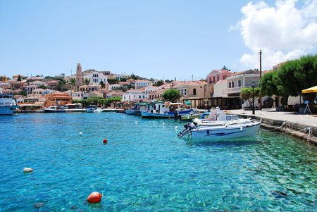 halki: Emborio, Greece - June 5, 2010 - Boats moored in the harbour on the Greek island of Halki.