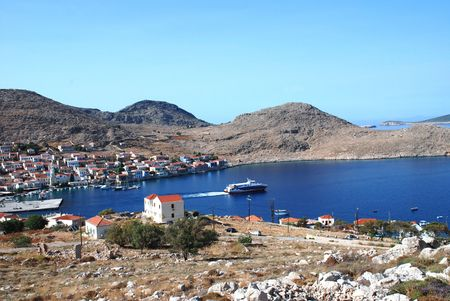 halki: Emborio, Greece -June 5, 2010 - Looking down onto the harbour on the Greek island of Halki. Editorial