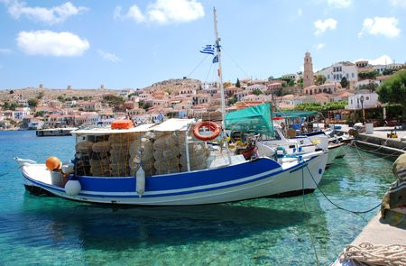 halki: Emborio, Greece - June 7, 2010 - Wooden fishing boats moored in the harbour on the Greek island of Halki.