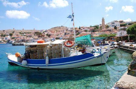 emborio: Emborio, Greece - June 7, 2010 - Wooden fishing boats moored in the harbour on the Greek island of Halki.