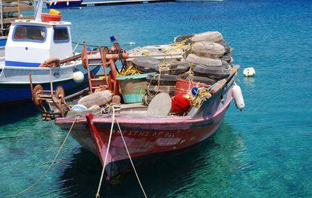 halki: Emborio, Greece - June 7, 2010 - Wooden fishing boats moored in the harbour on the Greek island of Halki.