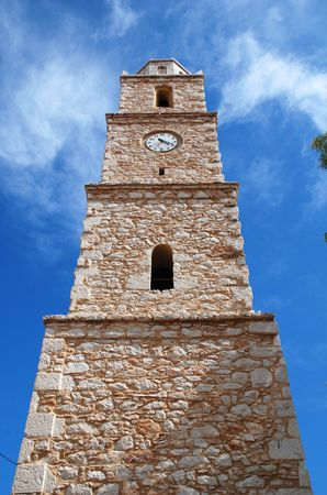halki: The stone clock tower at Emborio on the Greek island of Halki.