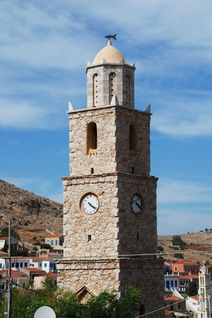 halki: The stone clock tower at Emborio on the Greek island of Halki.