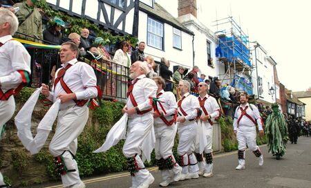 Hastings, England - May 3, 2010 - Morris dancers perform during the parade at the annual Jack In The Green festival. The event marks the May Day public holiday in Britain.