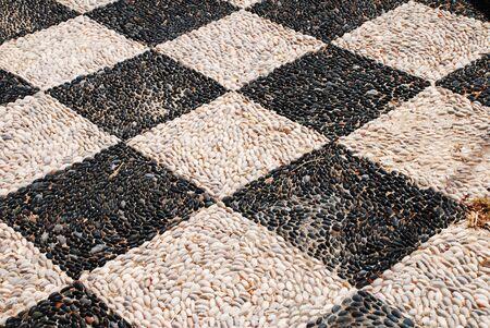emborio: The hoklakia mosaic courtyard of the Agios Nikolaos church at Emborio on the Greek island of Halki.