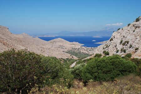 halki: Looking down to the coastline from the hills above Emborio on the Greek island of Halki. Stock Photo