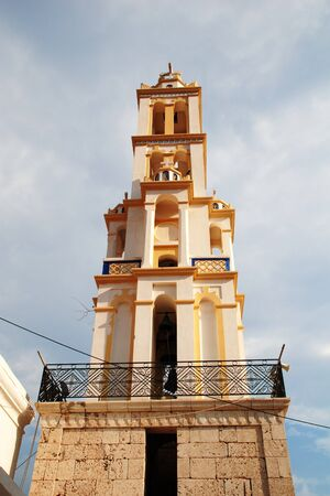 halki: The bell tower of the Agios Nikolaos church at Emborio on the Greek island of Halki. It is the tallest bell tower in the Dodecanese. Stock Photo