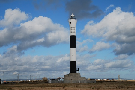 The new, automatic, lighthouse at Dungeness in Kent, England.  Stock Photo