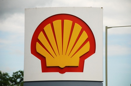 reported: Ashford, England - June 17, 2008 - Exterior of a Shell petrol filling station at Ashford, Kent. Royal Dutch Shell reported a 90% rise in profit for 2010. Editorial