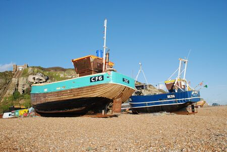 fishing fleet: Hastings, England - November 11, 2009 - Boats from the fishing fleet on the shingle beach at Hastings, East Sussex.  Editorial