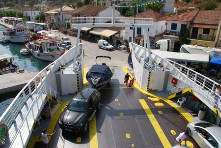 Meganissi, Greece - August 28, 2008 - A passenger & freight ferry calls at Vathi harbour on the Greece island of Meganissi. Editorial