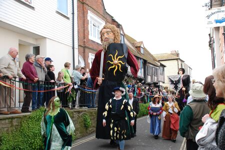 Hastings, England - May 5, 2009 - A large effigy of a man (known as a Giant) is paraded through the Old Town during the annual Jack In The Green festival. Stock Photo - 8757211